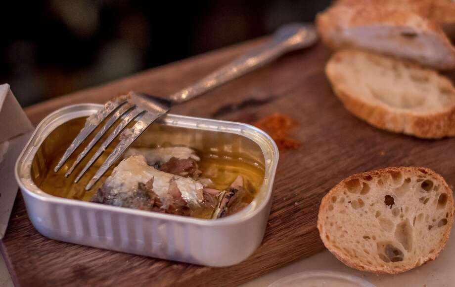 In addition to wine, Ordinaire offers cheese and charcuterie, and Portuguese sardines and bread, above. Photo: John Storey, Special To The Chronicle