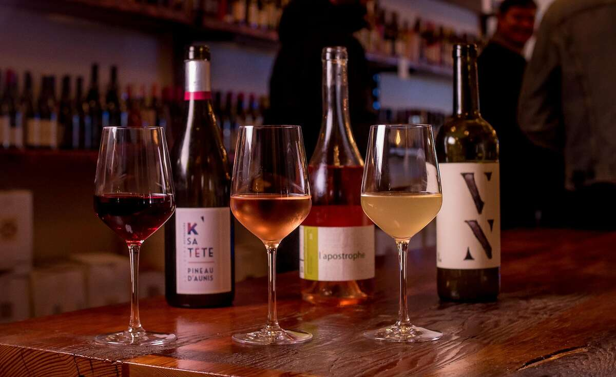 Left to right: Manor Tete de la Rouge, K SaTete Pineau d' Aunis; Domaines des Terres Promies L'Apostrophe Rose; and the Partitive Creus Vinel lo at the Ordinaire wine bar in Oakland, Calif. are seen on March 3, 2016.