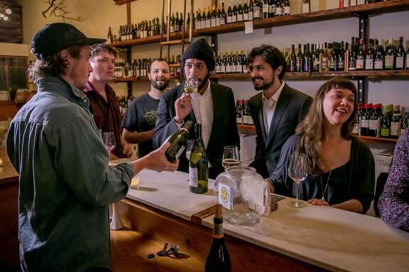 People enjoy wines at the Ordinaire wine bar in Oakland, Calif. on March 3, 2016.