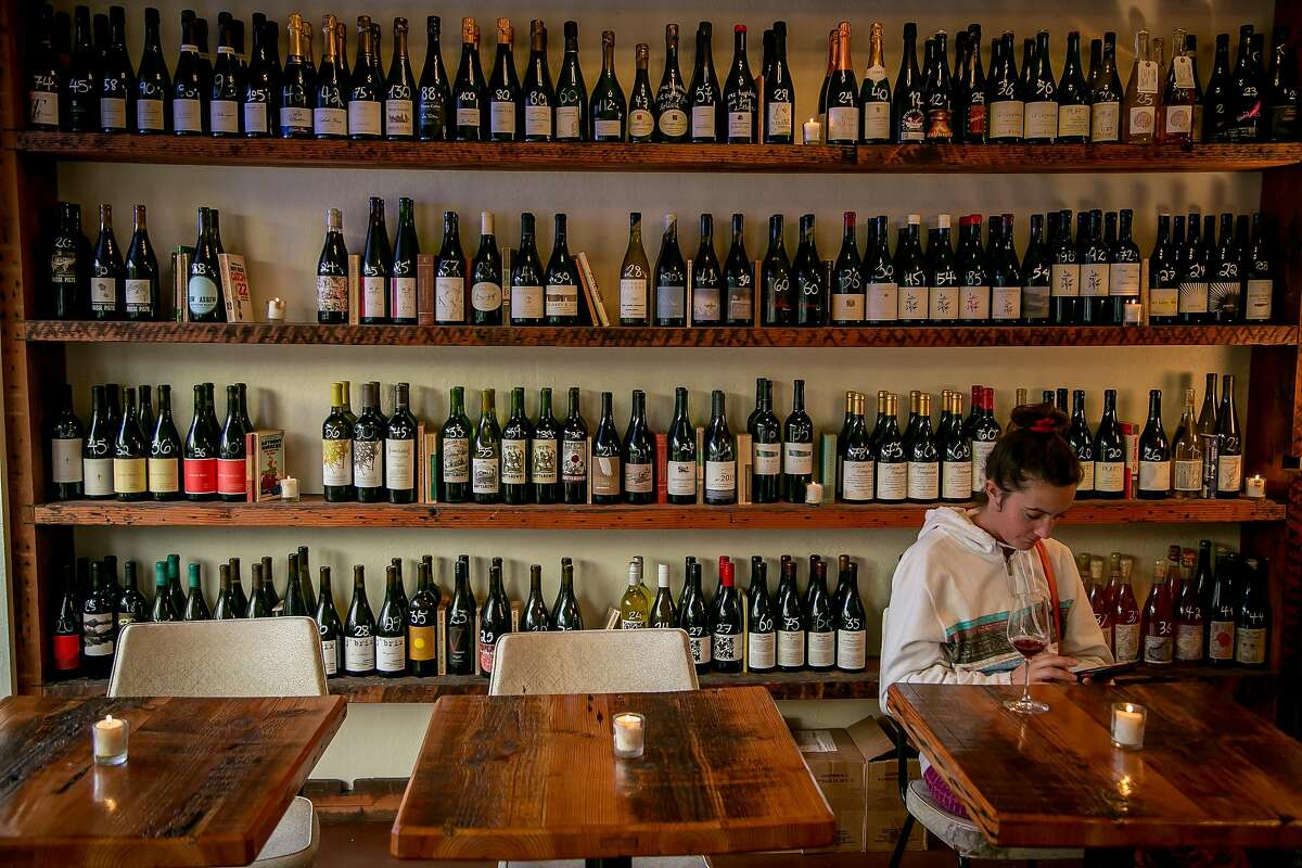 The wine selection at the Ordinaire wine bar in Oakland, Calif. is seen on March 3, 2016.