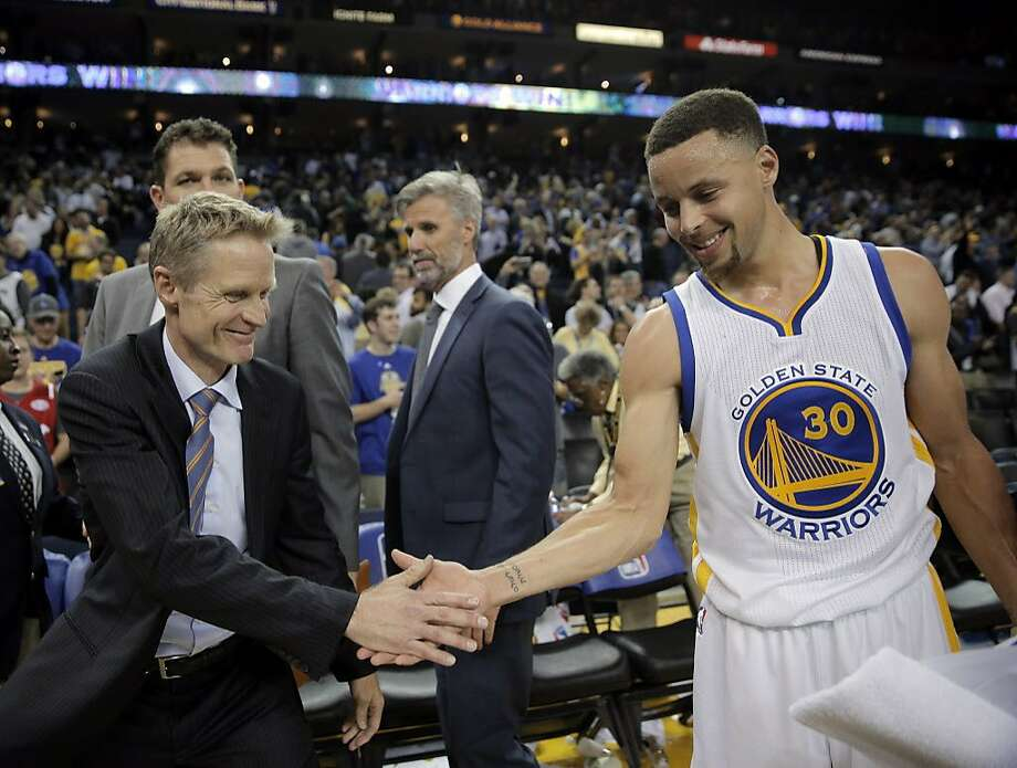 Steve Kerr and Stephen Curry celebrate after the win as the Golden State Warriors played the Oklahoma City Thunder at Oracle Arena in Oakland on Thursday, March 3, 2016. Photo: Carlos Avila Gonzalez, The Chronicle