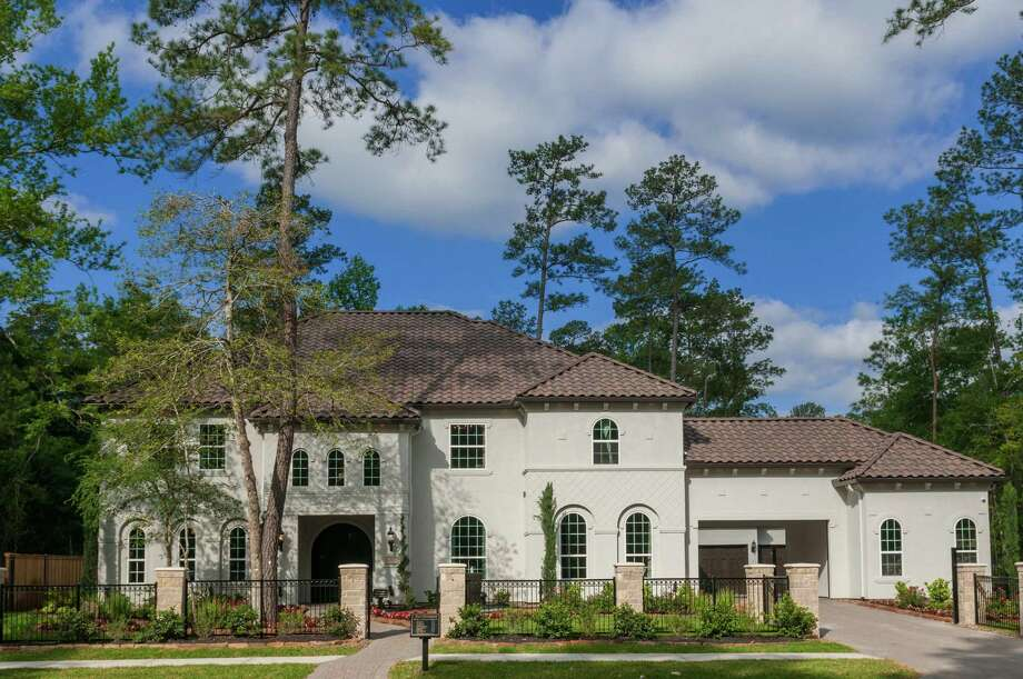 Sienna Plantation has several luxury designs available in gated neighborhoods. The homes, priced from the $720,000s, offer outdoor living areas with kitchens and fireplaces, raised media rooms and upscale finishes. Shown is a home design Toll Brothers is offering in Fox Bend. / Ted Washington