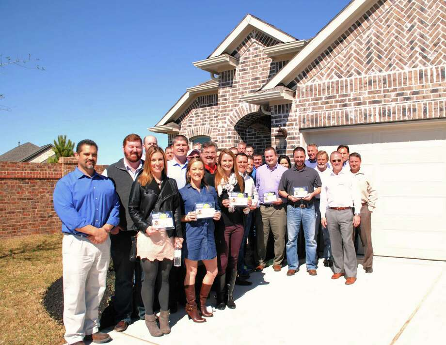 GHBA members who are donating to the GHBA Benefit home were honored at a luncheon at the home that is being built by Castletree Homes. Here they received an appreciation award.
