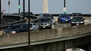 WASHINGTON, DC - APRIL 13:  The Washington Monument can be seen as traffic travels over the Frederick Douglass Memorial Bridge also known as the South Capitol Street bridge April 13, 2015 in Washington, DC. The bridge is one of 61,000 bridges across America that the Department of Transportation said were structurally deficient and in need of repair.