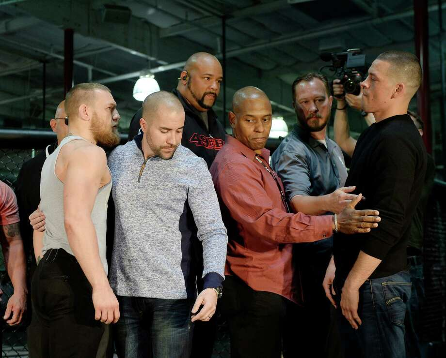 Conor McGregor (left) and Nate Diaz will square off in the main event of Saturday night's UFC 196 in Las Vegas.Browse through these photos for all the places around Houston where you can watch the fights. Photo: Kevork Djansezian, Getty Images / 2016 Kevork Djansezian