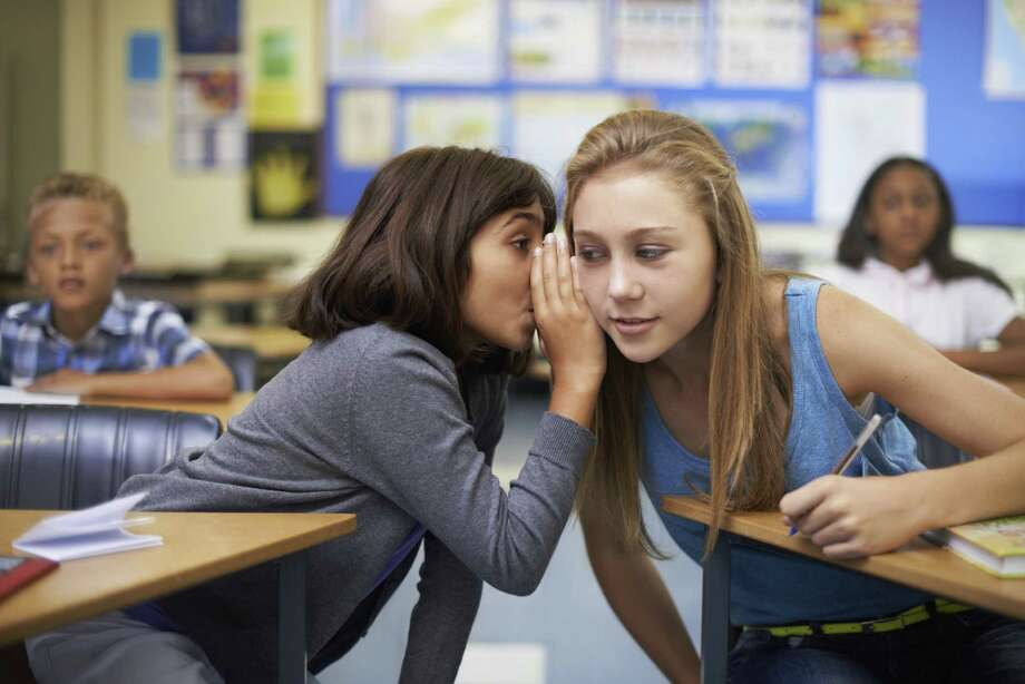 A child's parents are worried about what her friends are gossiping about at school. Photo: PeopleImages.com, Getty Images / (c) PeopleImages.com