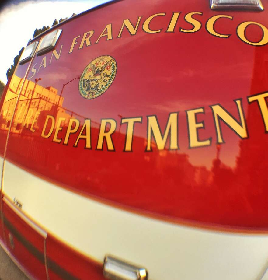 The San Francisco Fire Department and the city Department of Public Works are mopping up a large diesel spill caused by a leaking big rig on Friday at 28th an Noe Streets in Noe Valley. Photo: Bill Hutchinson