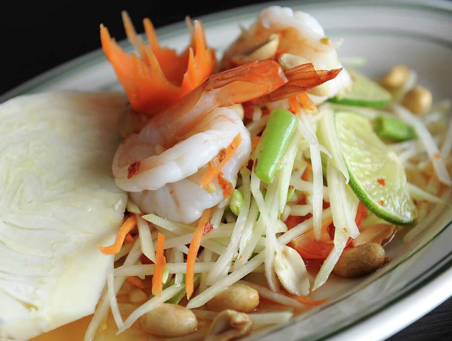 Papaya salad at Celadon Thai on Tuesday, March 1, 2016 in Latham, N.Y. Shedded green papaya with shrimp and peanuts topped with spicy garlic lime dressing. (Lori Van Buren / Times Union) Photo: Lori Van Buren / 10035633A