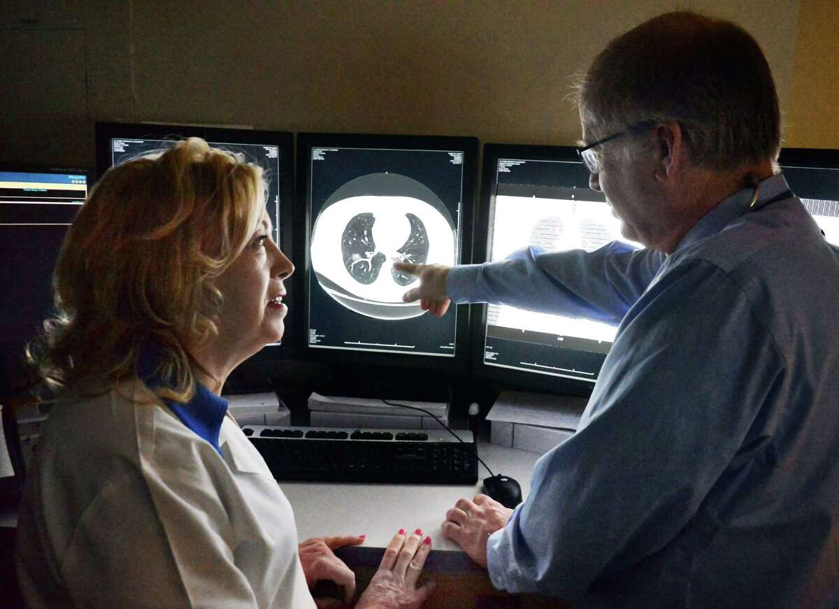 Division of Pulmonology and Critical Care nurse practitioner Jeanne Millett, left, and pulmonologist Dr. Thomas Smith review lung cancer screening scans at Albany Medical Center Friday Feb. 5, 2016 in Albany, NY. (John Carl D'Annibale / Times Union)