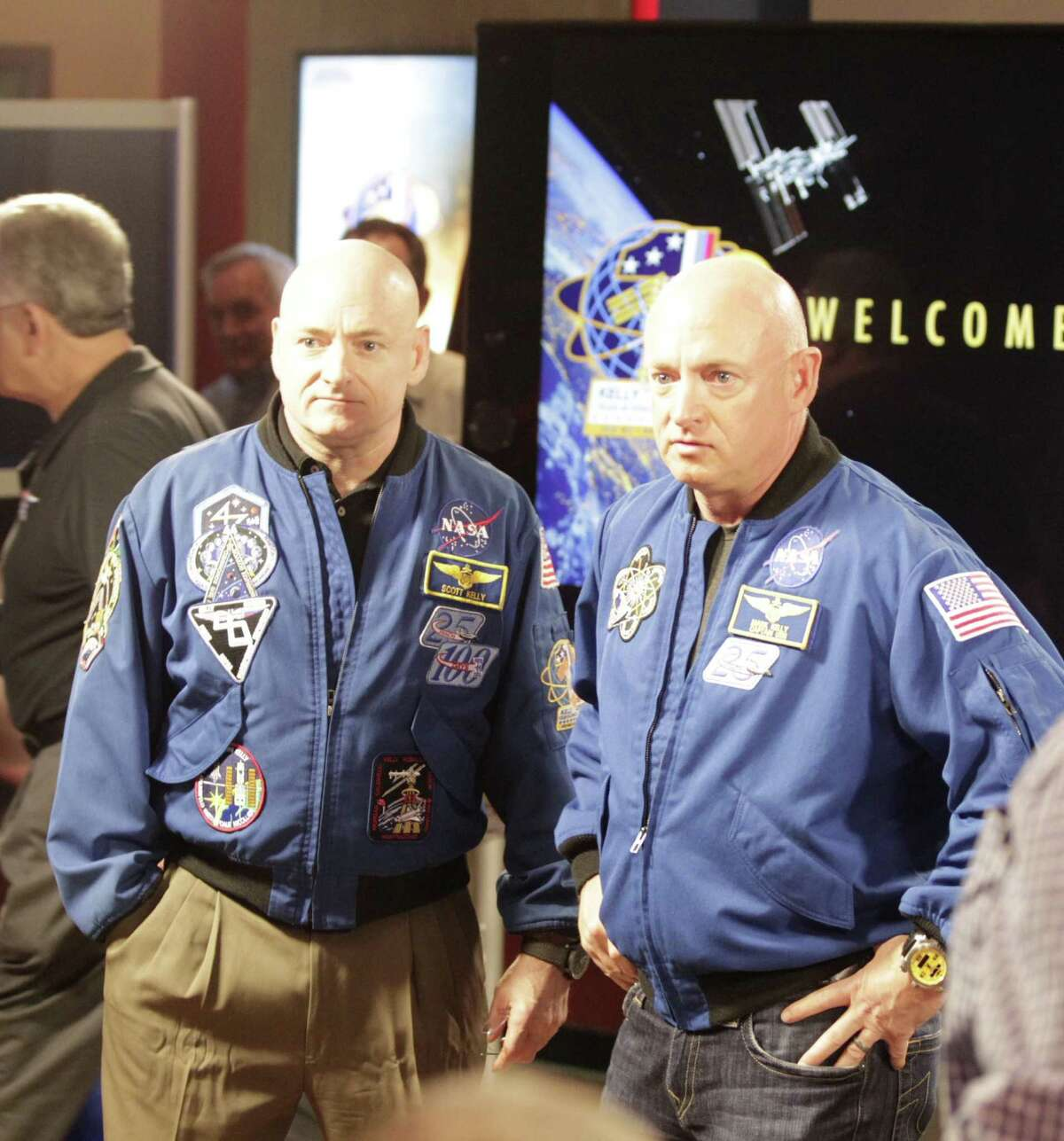 Scott Kelly left, and his twin brother Mark Kelly right, are pictured during a photo-op before a press conference at Johnson Space Center, Friday, March 4, 2016. Scott Kelly just completed nearly a year long stay aboard the International Space Station.