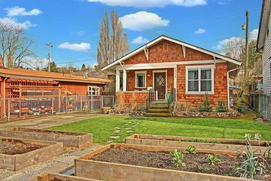 "The first home, 5004 26th Ave. S.W., is listed for $315,000. The two bedroom, one bathroom ""urban farmhouse"" features a large back deck and yard.There will be a showing for this home on Saturday, March 5 from 1 - 3 p.m. and Sunday, March 6 from 2 - 4 p.m. You can see the full listing here. Photo: Tanya Thackeray Wilson,  Windermere Real Estate Company"