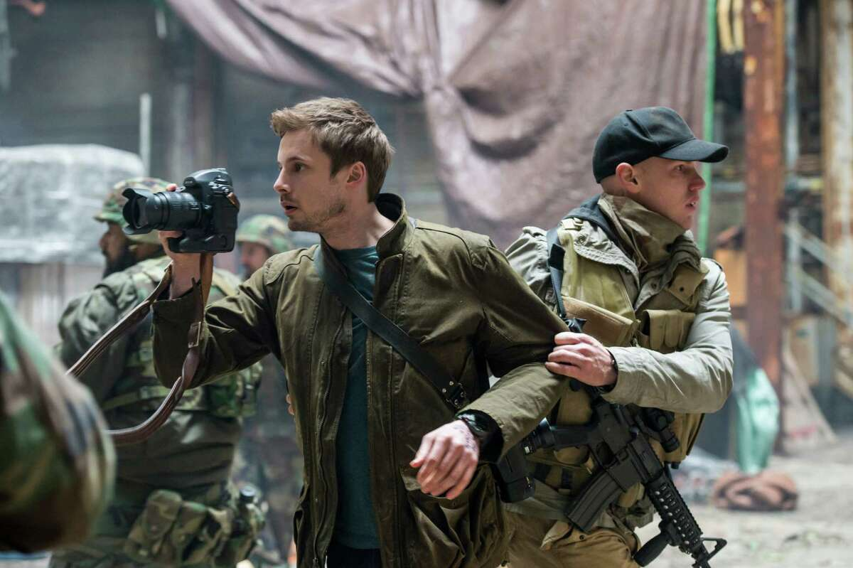 """Damien Thorne (Bradley James) is a war photographer with washboard abs in A&E's """"Damien: The Beast Rises."""""""