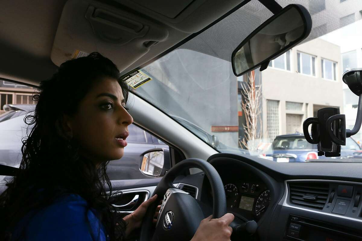 Copia founder Komal Ahmad drives to Cityteam Ministries where she will be making a surplus food delivery on Friday, February 26, 2016 in San Francisco, Calif.
