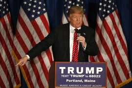 Republican presidential candidate Donald Trump says Mitt Romney had come to him begging for for help, Thursday, March 3, 2016,  during a campaign stop in Portland, Maine.(AP Photo/Robert F. Bukaty)