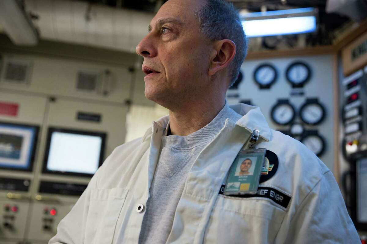 Chief engineer of the M/V Kaleetan, Brian Greenwood, stands in the engine room during a trip to Seattle from Bremerton, Friday, March 4, 2016. The engine room responds to requests from the bridge for different levels of power to the engines.