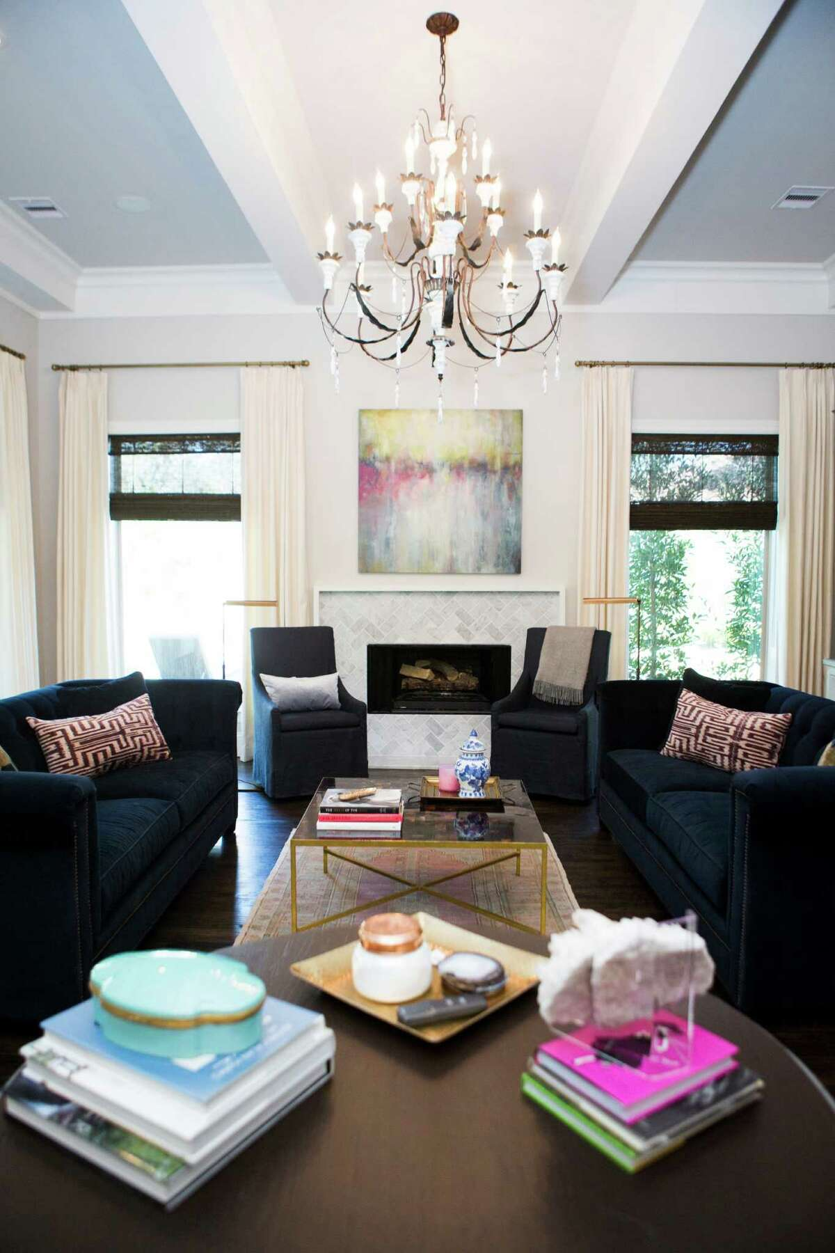 OR SKIP THE TV: The living room in this home has a soothing symmetry and plenty of seating. Designed to promote conversation, the room doesn't include a TV.