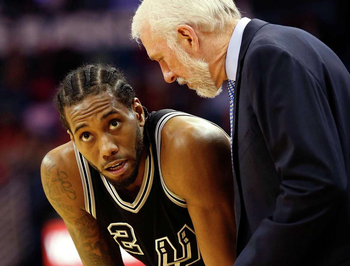 San Antonio Spurs forward Kawhi Leonard talks to San Antonio Spurs head coach Gregg Popovich between plays in the second half in New Orleans, on March 3, 2016.