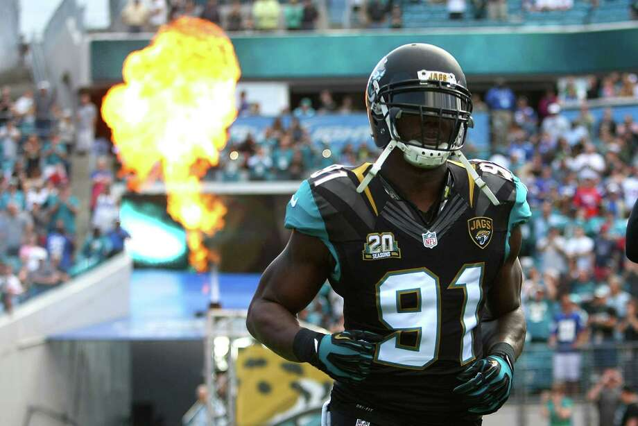 Defensive end Chris Clemons of the Jacksonville Jaguars runs onto the field for player introductions during an NFL football game between the New York Giants and the Jacksonville Jaguars at EverBank Field on November 30, 2014 in Jacksonville, Florida. Photo: Alex Menendez, Getty Images / 2014 Alex Menendez