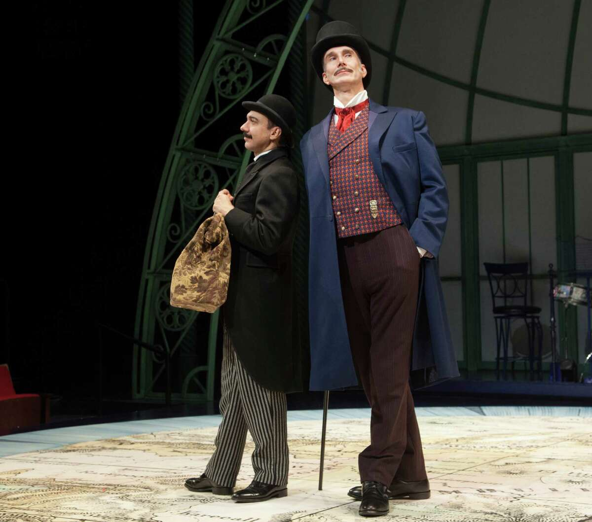 """Evan Zes as Passepartout and Todd Waite as Phileas Fogg in Alley Theatre's """"Around the World in 80 Days."""" Alley Theatre production press scenes of Around the World in 80 Days on 3-1-16 in Houston, Tx. photos by John Everett"""