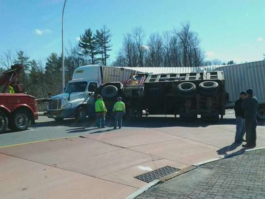 State Police said a dump truck driving on the Round Lake Bypass failed to yield at the roundabout with Round Lake Road, traveled over the center median of the roundabout and struck a semi-tractor and trailer that was south on Round Lake Road inside the roundabout. (Photo courtesy Tim Downey)
