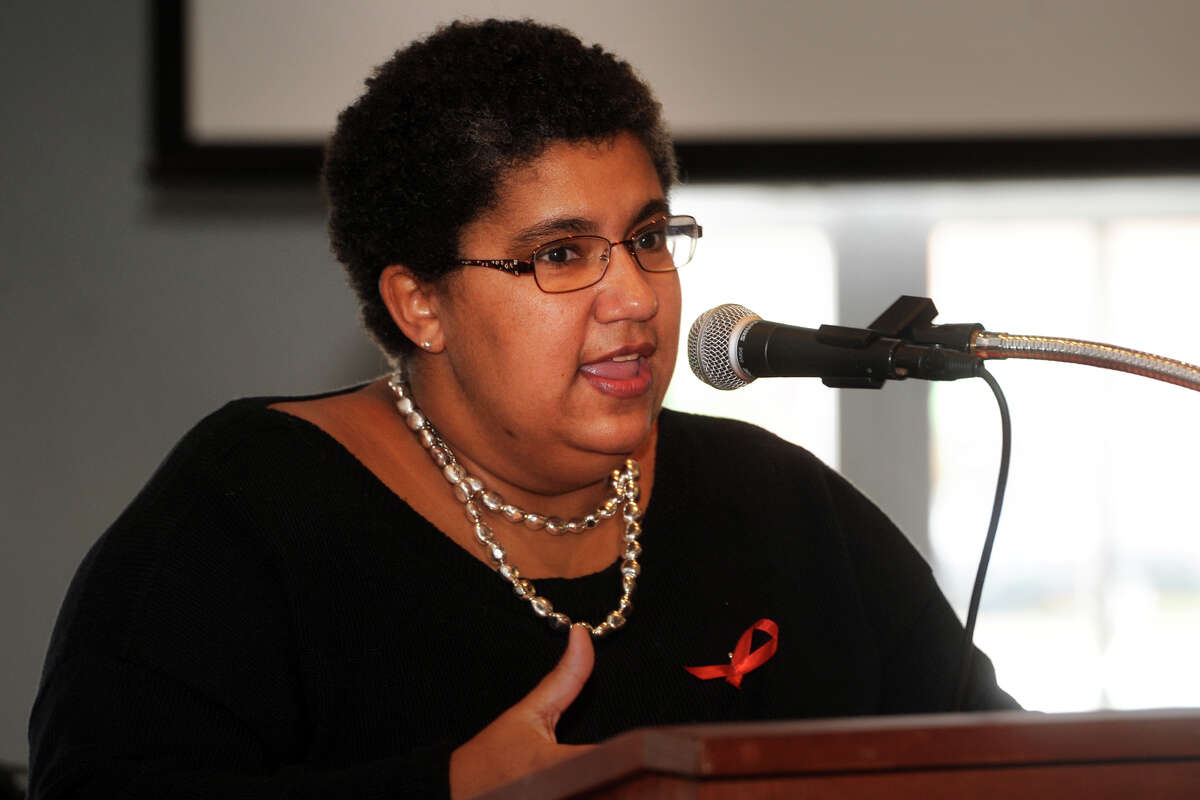 Kristin duBay Horton, Director of Health & Social Services for the City of Bridgeport, speaks during The Greater Bridgeport HIV/AIDS Care Consortium in 2014.