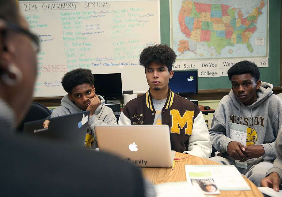 African-american community liaison Linda Jordan advises seniors from the basketball team Authman Ibrahim (left), Atim Mansori (middle), and Alphonzo Asberry (right) on college, scholarships, and financial aid applications at Mission High School in San Francisco, California, on friday,  march 4, 2016.  Google is giving a racial justice grant for their MyBrothers Sisters Keeper initiative ensuring every African American senior  will have individualized mentoring and guidance for financial aid. Photo: Liz Hafalia Elizabeth Hafalia, The Chronicle