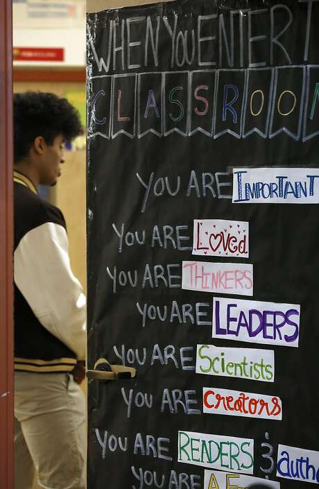 African-american community liaison Linda Jordan advises seniors on college, scholarships, and financial aid applications at Mission High School in San Francisco, California, on friday,  march 4, 2016.  Senior Hatim Mansori is seen through her classroom door. Photo: Liz Hafalia Elizabeth Hafalia, The Chronicle