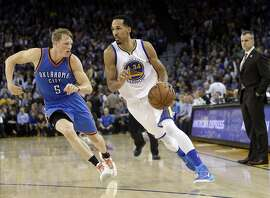 Golden State Warriors' Shaun Livingston (34) dribbles past Oklahoma City Thunder's Kyle Singler (5) during the second half of an NBA basketball game Thursday, March 3, 2016, in Oakland, Calif. Golden State won 121-106. (AP Photo/Marcio Jose Sanchez)