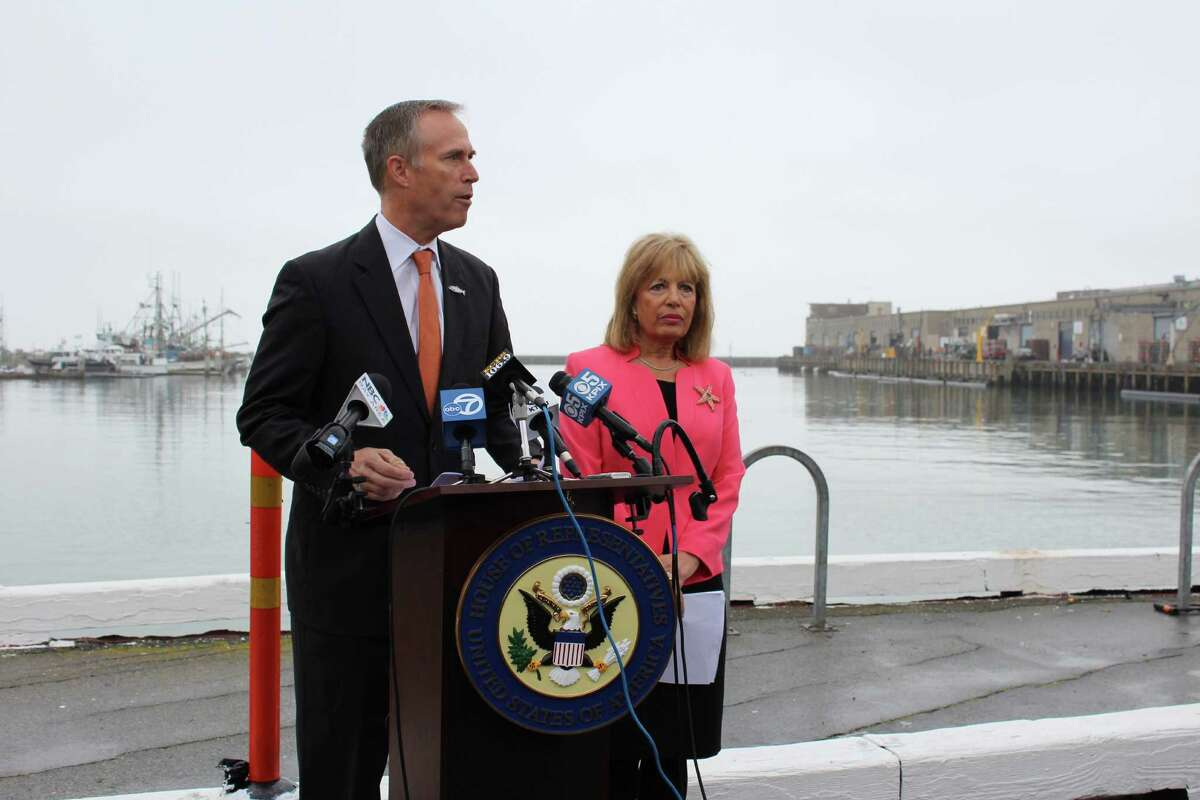 Reps. Jared Huffman and Jackie Speier speak at a news conference Friday in Fisherman's Wharf to announce the introduction of a bill that would provide disaster relief to the crabbing industry.