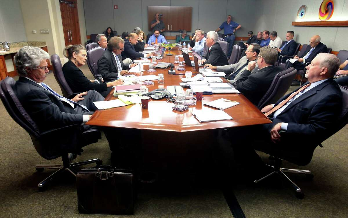 Negotiators from the city, left, and the San Antonio police union, right, meet Tue., Aug. 18, 2015 in the convention center during collective bargaining agreement negotiations.