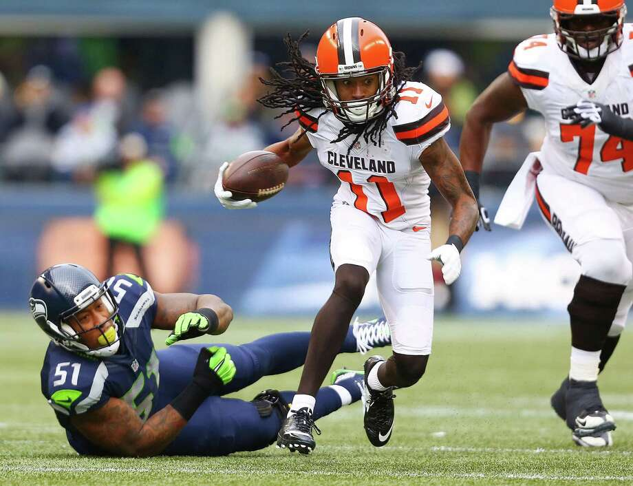 Browns' Travis Benjamin evades a tackle attempt from Bruce Irvin during the first quarter of the Seahawks game against Cleveland, Sunday, Dec. 20, 2015 at CenturyLink Field.  The Seahawks won 30-13. Photo: GENNA MARTIN, SEATTLEPI.COM / SEATTLEPI.COM