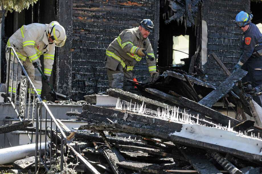 Fire investigators work the scene of a fire at 1052 Parkwood Boulevard on Friday March 4, 2016 in Schenectady, N.Y.  (Michael P. Farrell/Times Union) Photo: Michael P. Farrell / 10035723A