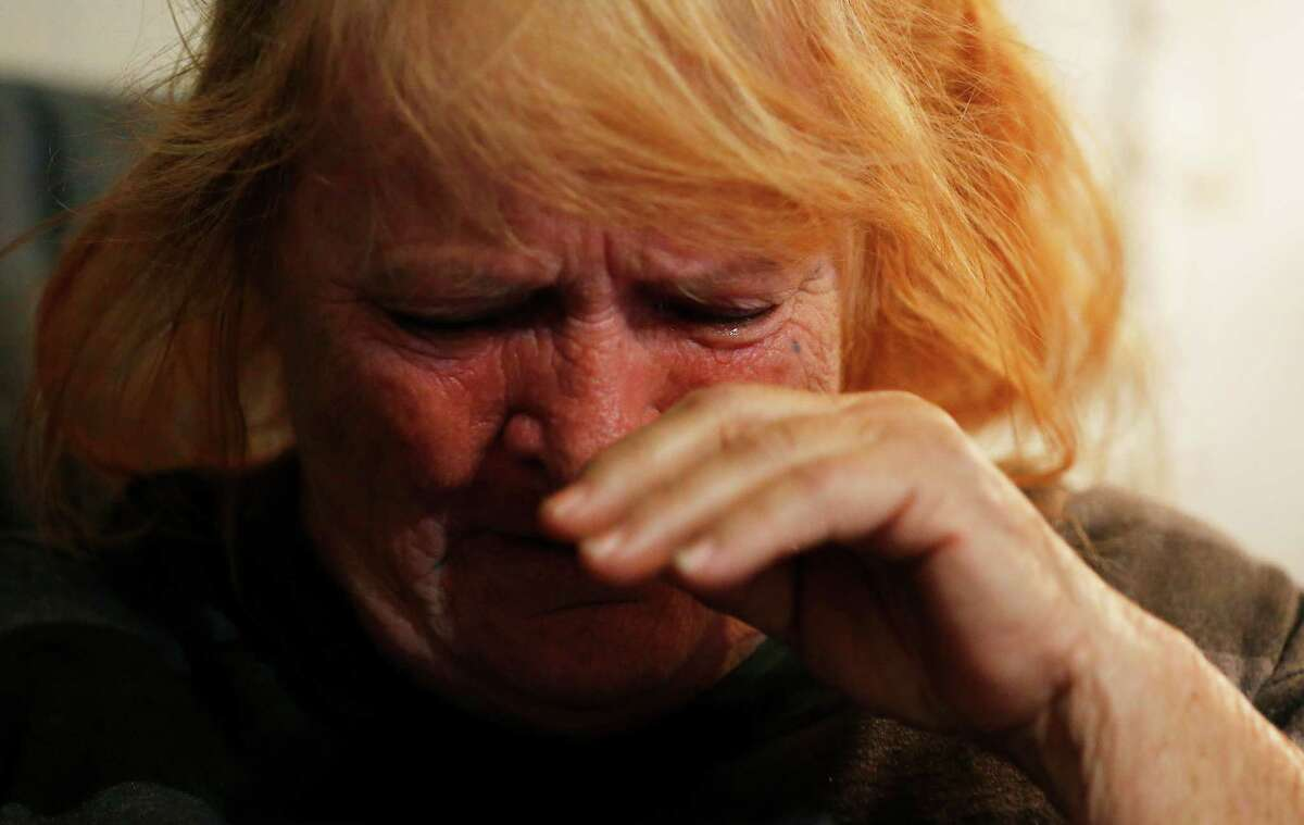 Dorothy Patton Barrera cries while explaining why she is fighting to have the cremated remains of her husband, Pedro, buried at the San Domingo Cemetery in Normanna, Texas on Friday, Mar. 4, 2016. However, Barrera wishes were refused by Jimmy Bradford who is the apparent caretaker for the cemetery. Barrera was initially told that Hispanics nor black persons were allowed to be buried there. Barrera railed against the idea of not being allowed to do so and has hired attorney Sid Arizmendez of Beeville to help rectify the situation. Late Friday, Barrera was informed that Bradford reconsidered his position and has allowed her to bury her husband at the cemetery. Barrera, however, is still considering or legal action so that future issues regarding race will not take place at the cemetery.