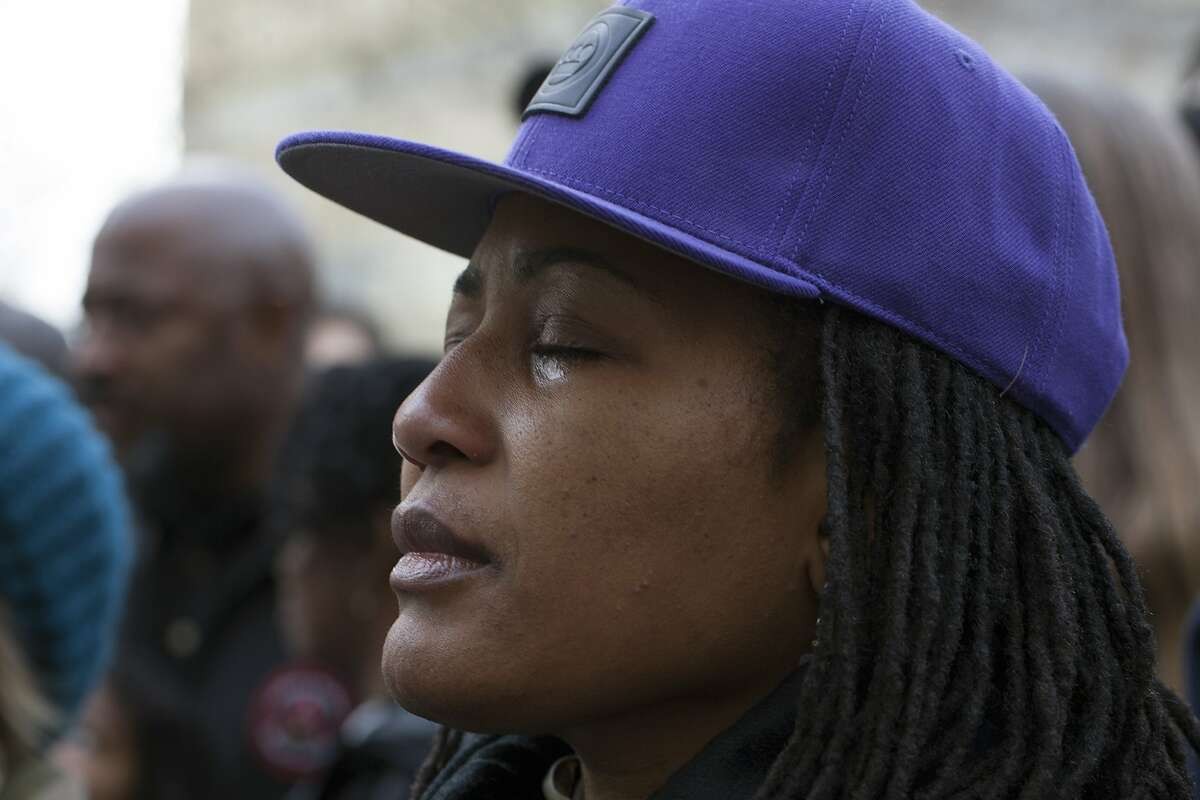 Lynette Gibson McElhaney is emotional while speakers read off a list of black people killed by police at Frank Ogawa Plaza during a Day of Resistance or the Millions March in Oakland, Calif. on Saturday, December 13, 2014.