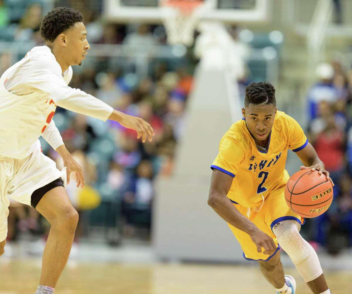 Ken Busby (2) of the Elkins Knights drives to the basket in the second half against the Yates Lions in high school basketball's 5A Region III semifinals on Friday, March 4, 2016 at the Merrell Center.