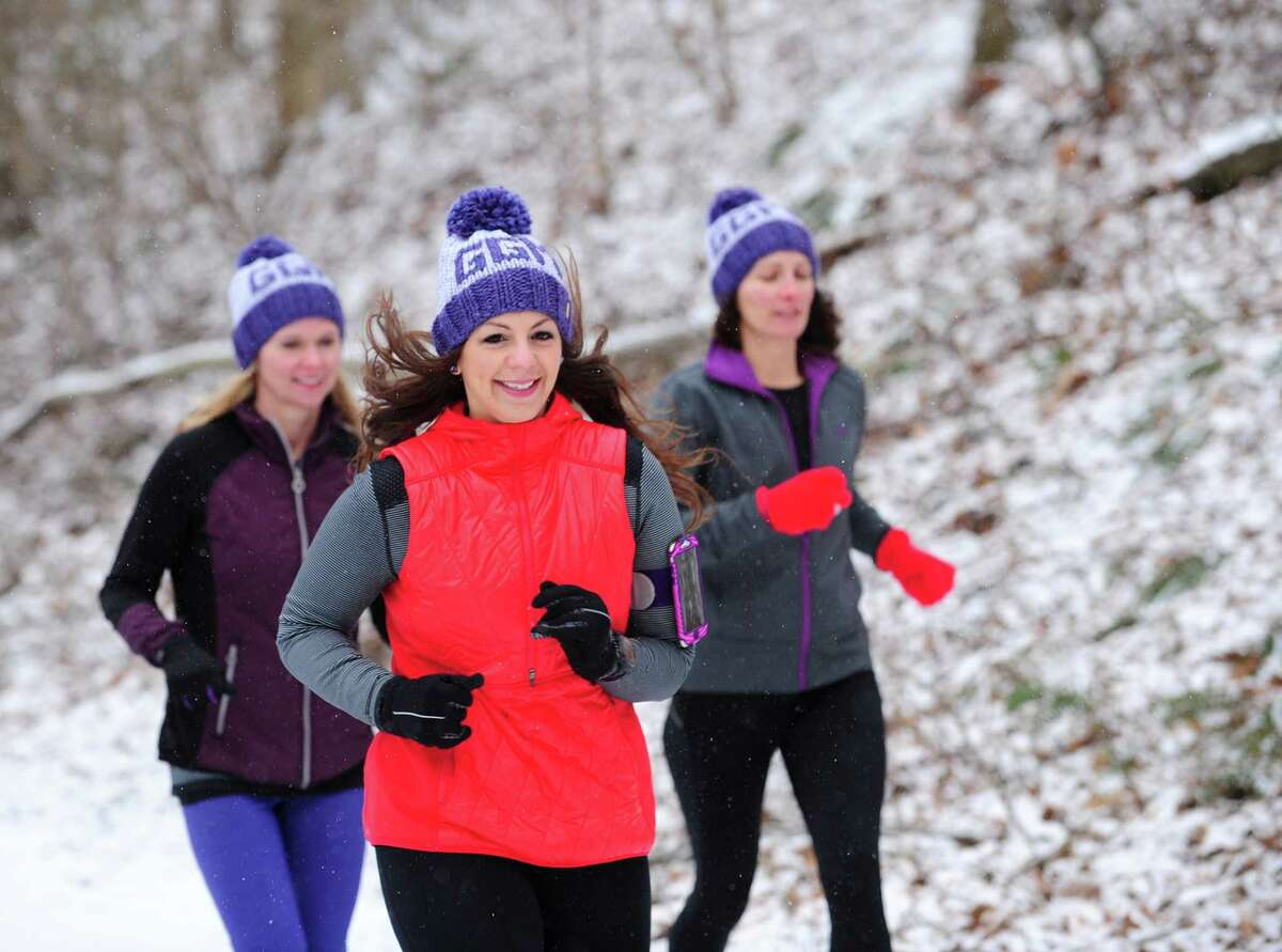 Gina Ancona, center, flanked by Kelly Buck, left, and Sharon Mullen trains with her running group, Girls Gone Miles, Friday, Mar. 4, 2016 along the Pequonnock River Trail off Taits Road in Trumbull, Connecticut. The all-women running group in Trumbull trains for the 200-mile RAGNAR at Cape Cod in May every year and is also involved in philanthropy. In March they will be holding a fundraiser in Westport to benefit the McGivney Community Center in Bridgeport. Last year they raised about $13,000 for the Lyme Research Alliance.