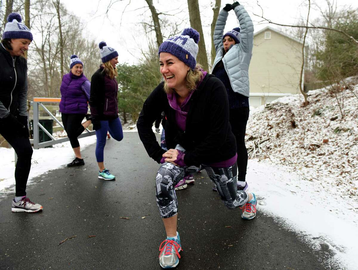 Nikki Satin stretches before a run with members or her running and training group, Girls Gone Miles, Friday, Mar. 4, 2016 at the head of the Pequonnock River Trail off Taits Road in Trumbull, Connecticut. The all-women running group in Trumbull trains for the 200-mile RAGNAR at Cape Cod in May every year and is also involved in philanthropy. In March they will be holding a fundraiser in Westport to benefit the McGivney Community Center in Bridgeport. Last year they raised about $13,000 for the Lyme Research Alliance.
