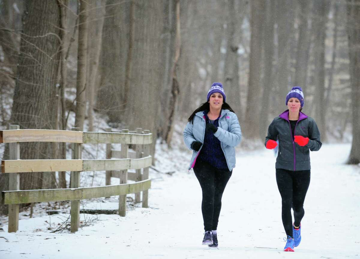 Girls Gone Miles members Caroline Minella, left, and Sharon Mullen finish a run along the Pequonnock River Trail Friday, Mar. 4, 2016 in Trumbull, Connecticut. The all-women running group in Trumbull trains for the 200-mile RAGNAR at Cape Cod in May every year and is also involved in philanthropy. In March they will be holding a fundraiser in Westport to benefit the McGivney Community Center in Bridgeport. Last year they raised about $13,000 for the Lyme Research Alliance.
