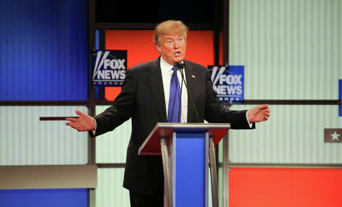 """Donald Trump, a Republican hopeful, speaks during the Republican presidential debate at the Fox Theater in Detroit, March 3, 2016. A gobsmacking day of intraparty pie-throwing ended with Trump assuring the American public that the size of his male appendage was just fine. ?I guarantee you,? he said, """"there's no problem."""" (Richard Perry/The New York Times)"""