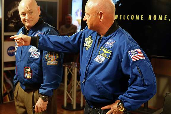 NASA astronaut Scott Kelly, left, was joined by his twin brother, Mark, at a news conference Friday following Scott's 340 days aboard the International Space Station.