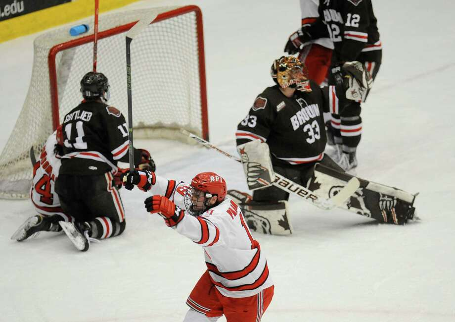 Rensselaer Polytechnic Institute's Mike Prapavessis (19) celebrates his goal against Brown during the second period of Game 1 of a Eastern College Athletic Conference hockey playoff series in Troy, N.Y., Friday, March 4, 2016. (Hans Pennink / Special to the Times Union)      ORG XMIT: HP103 Photo: Hans Pennink / Hans Pennink