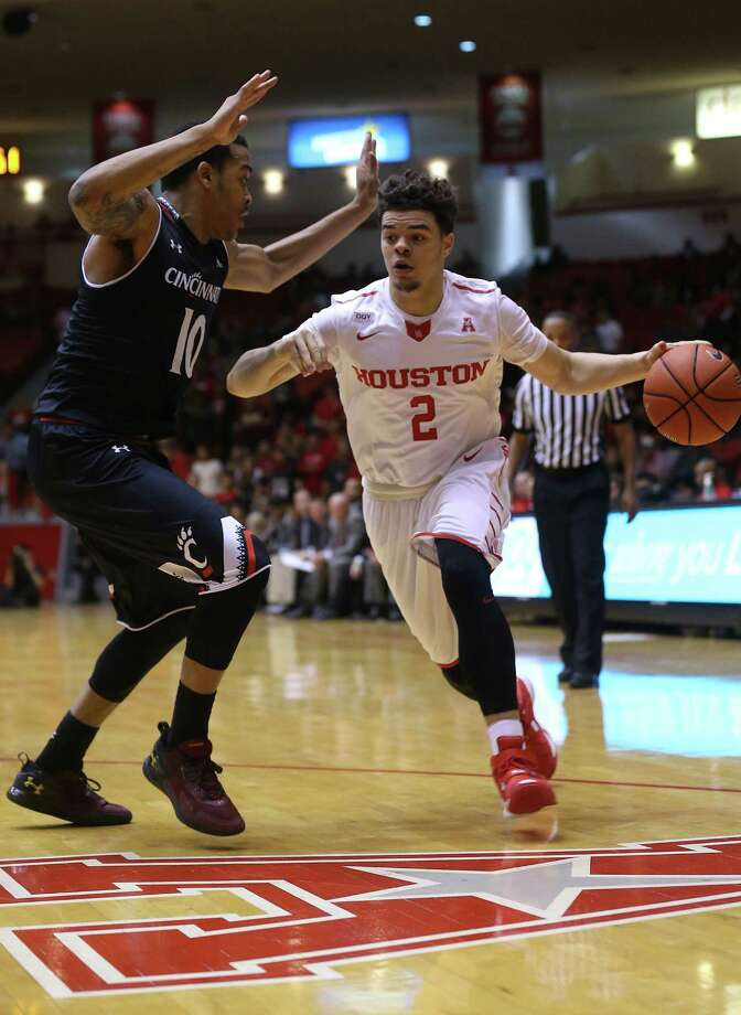 Cutting down on overly physical play has given players such as University of Houston guard Rob Gray Jr. (2) more room to maneuver this season. Photo: Elizabeth Conley, Staff / © 2016 Houston Chronicle