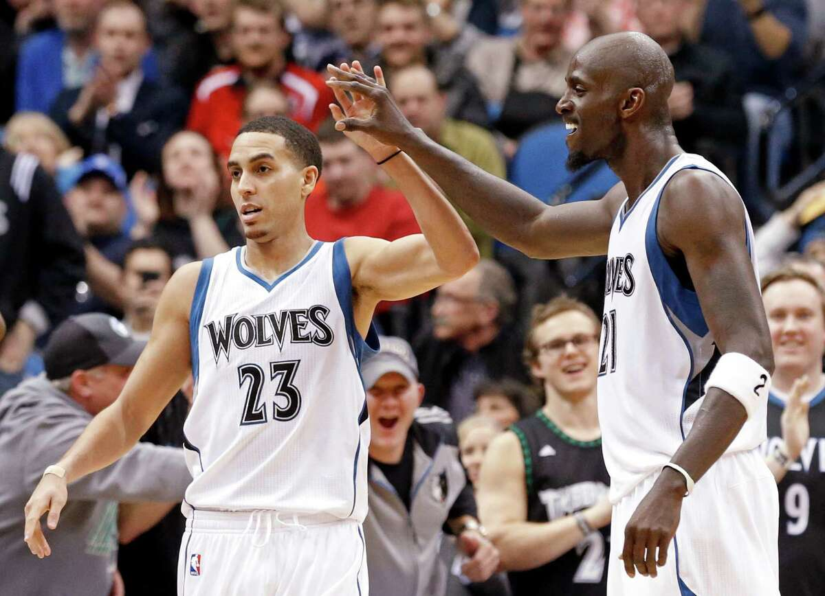 Minnesota Timberwolves?' Kevin Garnett, right, congratulates Kevin Martin after a basket in the second half of an NBA basketball game, Wednesday, Feb. 25, 2015, in Minneapolis. The Timberwolves won 97-77. Martin led his team with 28 points. (AP Photo/Jim Mone)