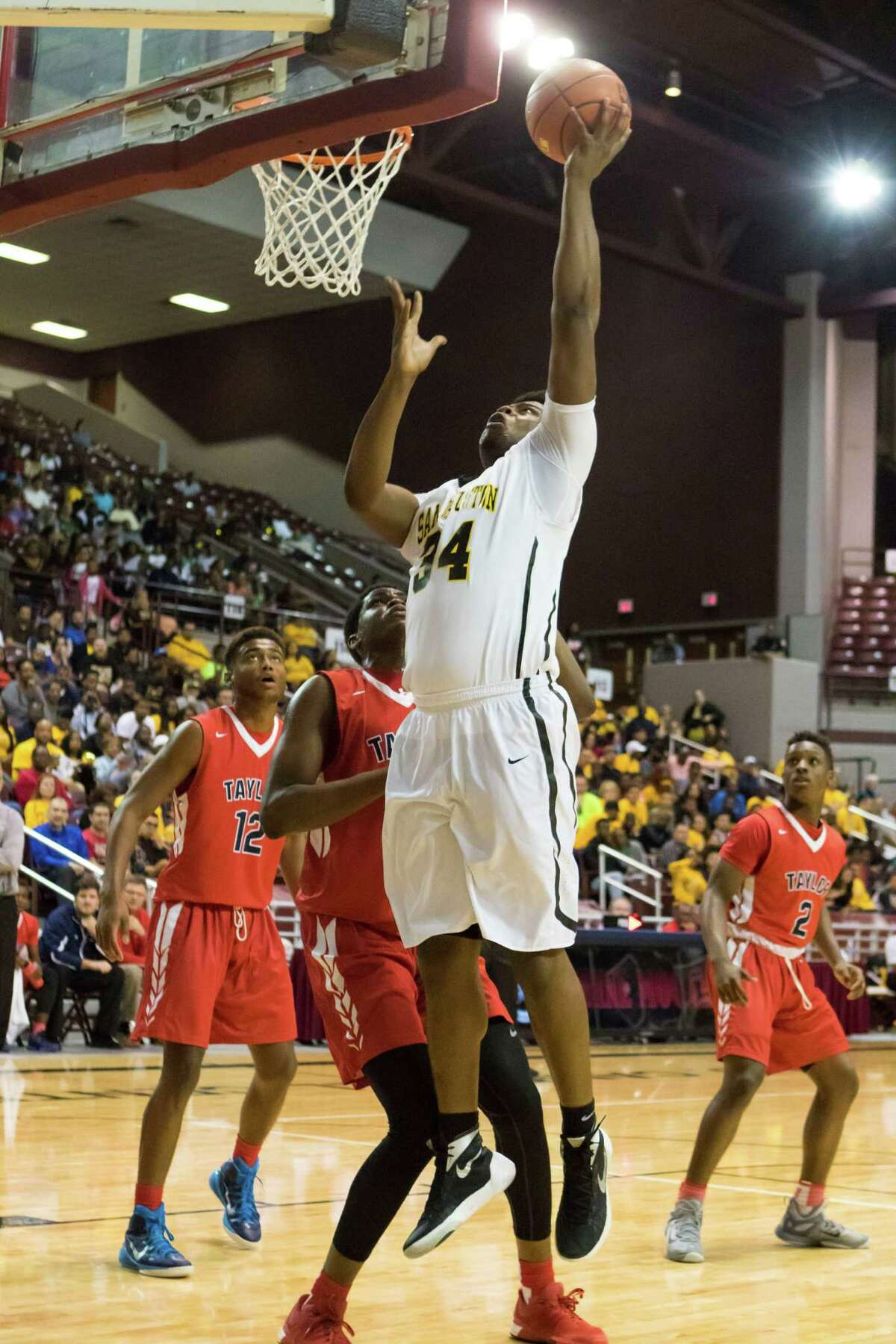 Sam Houston Tigers forward Carlton Prejean (34) puts back a rebound in the first quarter against the Alief Taylor Lions in the Class 6A Boys Basketball Region III semifinals at the Campbell Center, Friday, March 4, 2016, in Houston, TX.