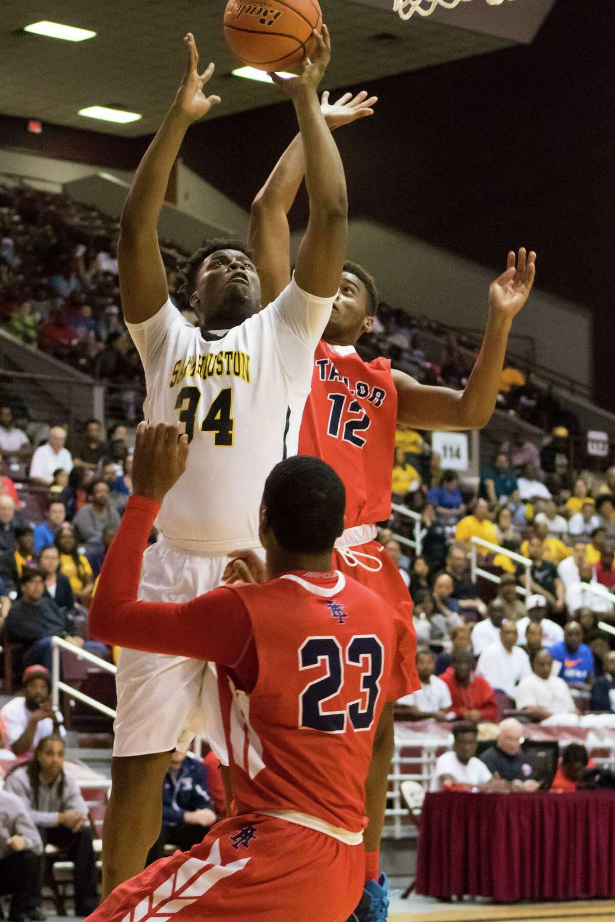 Sam Houston Tigers' Carlton Prejean (34) goes for a lay up against Alief Taylor in the Class 6A Boys Basketball Region III semifinals at the Campbell Center, Friday, March 4, 2016, in Houston, TX.