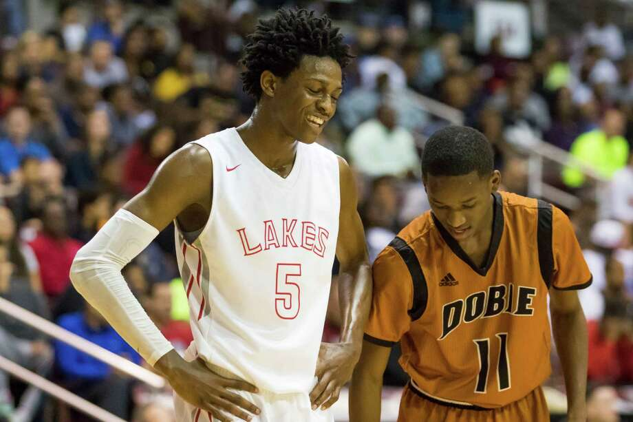 Cypress Lakes Spartans' guard De'Aaron Fox (5) jokes with Dobie Longhorns guard Jeremy Williams (11) late in the fourth quarter of the Class 6A Boys Basketball Region III semifinals at the Campbell Center, Friday, March 4, 2016, in Houston, TX. Cpyress Lakes would go on to defeat Dobie 79-70 Photo: Joe Buvid Joe Buvid, For The Chronicle / © 2015 Joe Buvid
