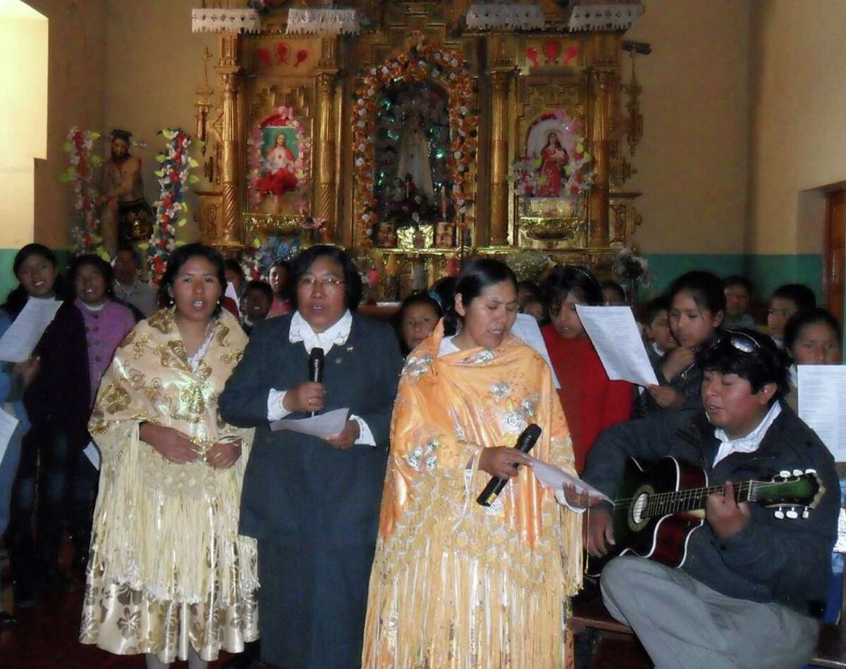 Sisters Mary Luz, Hirayda, and Sofia, front, with the microphone, celebrating 25 years of missionary presence in Huancané in the Andes area in 2010.