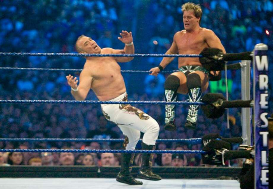 "HOUSTON, TX - APRIL 5:  (L-R) Former professional wrestler Ricky ""The Dragon"" Steamboat gets kicked by WWE Superstar Chris Jericho during WrestleMania 25 at Reliant Stadium on April 5, 2009 in Houston, Texas.  (Photo by Bill Olive/Getty Images) *** Local Caption *** Chris Jericho;Ricky ""The Dragon"" Steamboat Photo: File Photo / Stamford Advocate File Photo"