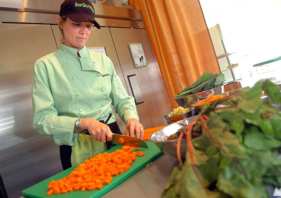Owner and chef Linda Soper-Kolton chops carrots for her Scarlet Soup at Green Gourmet to Go in the Black Rock section of Bridgeport, offering local organic vegetarian and vegan meals. Photo: Autumn Driscoll / Connecticut Post