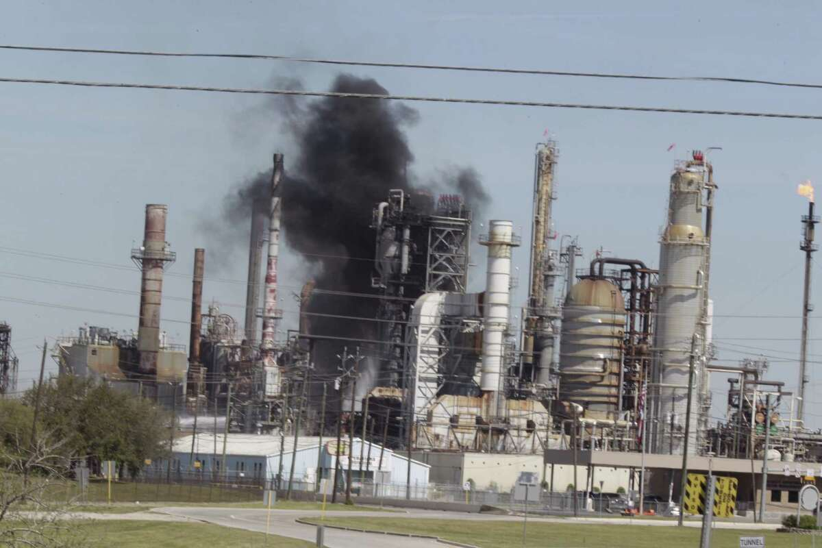 Smoke rises from a fire in 2016 at the Pasadena Refinery. It's one of five Texas polluters issued permits that a watchdog group says are confusing and difficult to enforce. The Environmental Integrity Project sued the U.S. Environmental Protection Agency over the permits on Thursday, July 20, 2017.